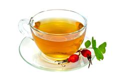 Tea with rosehip in a cup Stock Photos