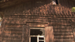 Tilt medium close up of derelict wooden house in Chernobyl Allienation Zone Stock Footage