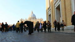 Crowds at St Peters ignore beggar (dolly) Stock Footage