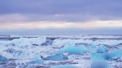 Ocean wave smashing Iceberg stuck Stock Footage
