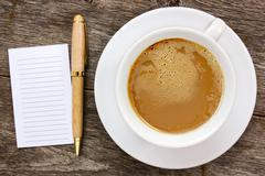Stock Photo of blank paper with hot coffee cup