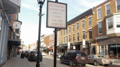 No Parking sign and Loading Zone on Main Street - stock footage