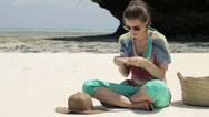 Stock Video Footage of Young woman texting, sending sms on smartphone, beautiful exotic beach HD