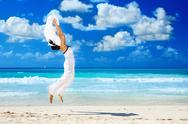 Stock Photo of happy woman with white sarong