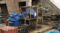 Fishing pots on a quay side Stock Footage