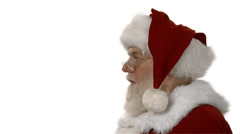 A side profile of Santa blowing a kiss standing on a white background Stock Footage
