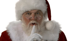 Santa standing and motioning with his finger to be quite on a white background Stock Footage