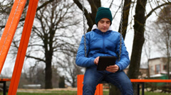 Teen with tablet PC episode 1 Stock Footage