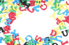 jumble of colorful foam rubber letters - stock photo