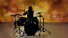Silhouetted drummer playing in a magical cloudscape. Really cool. - stock footage