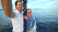 Stock Video Footage of Man and woman enjoying sailboat trip on adriatic in Croatia