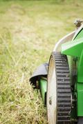 Closeup of lawnmower in the garden ready to cut Stock Photos