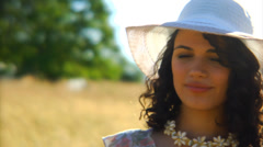 Woman with hat in field. Stock Footage