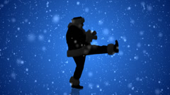 Santa's Silhouette dances with the glee of the holiday season on blue - stock footage