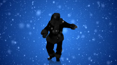 Santa's Silhouette dances with the glee of the holiday season on blue Stock Footage