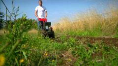 A man tills his field. Stock Footage