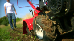 A farmer starts tilling his field. Stock Footage
