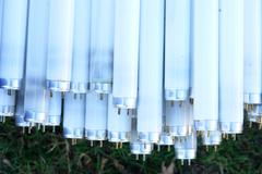 many fluorescent neon tube lamps - stock photo