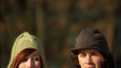 Young couple show concerns in their eyes at the park. - stock footage