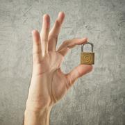 hand holding padlock with copyright symbol - stock photo
