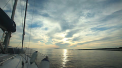 Sailing through the islands on sailing boat in Croatia at sunset Stock Footage