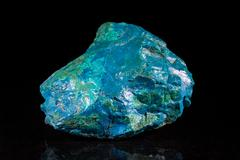 Chrysocolla mineral stone in front of black Stock Photos