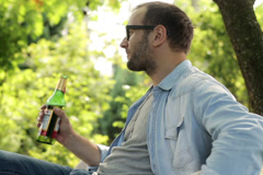 Man drinking beer in the garden Stock Footage