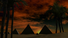 Sunset over pyramids in the dessert Stock Footage