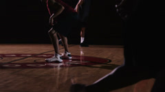 A basketball player runs down the court past defenders and then scores Stock Footage