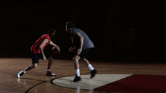 A basketball player dribbles past a defender and then dunks the ball Stock Footage