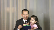 Stock Video Footage of Man with daughter playing with digital tablet