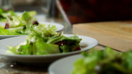 Stock Video Footage of Plates of Salad are topped with Cheese