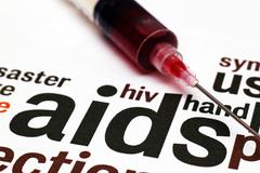 Aids and syringe concept Stock Photos