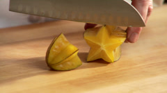 A chef slicing yummy starfruit. Stock Footage