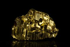 Pyrite mineral stone in front of black Stock Photos