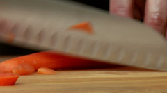 Close up of a chef carefully cutting some carrots Stock Footage