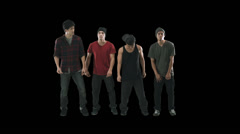 A group of young men stand in a line and take turns dancing Stock Footage