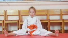 Sitting on tatami athlete doing exercises karate Stock Footage