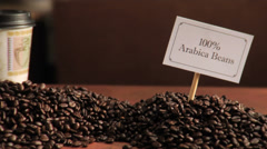 An espresso cup placed on a pile of roasted coffee beans Stock Footage