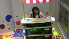 Happy Little Girl Playing with Color Toys - stock footage