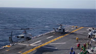 Stock Video Footage of Amphibious Assault Ship USS Bataan conduct a strait transit exercise