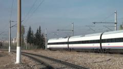 Turkish high speed train rides across tracks on Ankara Istanbul line - stock footage