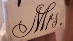 "Bride's ""Mrs."" wedding reception rustic sign pan and rack focus Stock Footage"