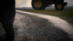 A farmer walking towards a tractor in the early morning Stock Footage
