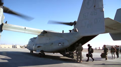 V22 Mv22 Osprey Helicopter loading passengers Stock Footage