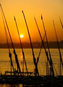 felucca boats at the harbor at sunset, luxor - stock photo