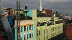 A time lapse of a crane and elevator working near a building in Brooklyn NY Stock Footage