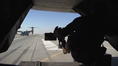 V22 Mv22 Osprey Helicopter rear door gunner takeoff Stock Footage
