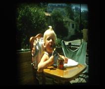 Baby girl eating gerbers Stock Footage