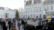 Musician and Tourists at Burg, Bruges, Belgium. Stock Footage